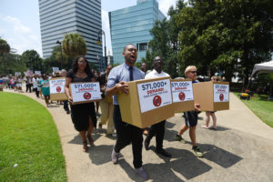 COLUMBIA, S.C. - JULY 7: Activists deliver boxes of MoveOn petitions to take down the Confederate flag in front of the Statehouse on July 7, 2015 in Columbia, South Carolina. (Photo by Rainier Ehrhardt/Getty Images for MoveOn.org)