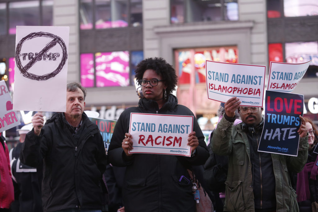 """NEW YORK, NY - MARCH 16: Members of MoveOn.org Political Action stand outside the studios of ""Good Morning America"" to broadcast messages of love, dignity, and equality and stand up against the hate, racism, and incitement of violence that the group says has become a hallmark of Donald Trump's presidential campaign in New York City on Wednesday, March 16, 2016 in New York City. (Photo by Thos Robinson/Getty Images for MoveOn.org Political Action)"""